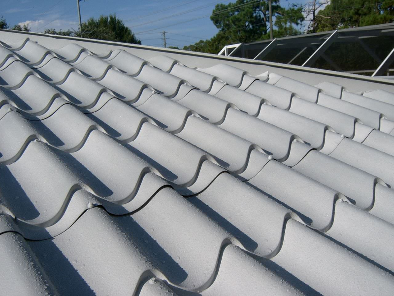 Metal roofing photos classic metal roofing systems for Metal roof that looks like spanish tile