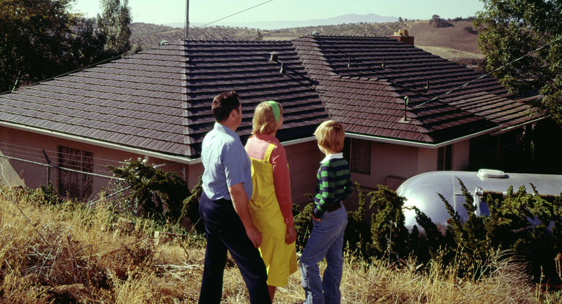 family looking at their new Rustic Shingle Roof