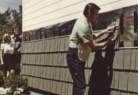 contractor installing rustic shingle in 1966