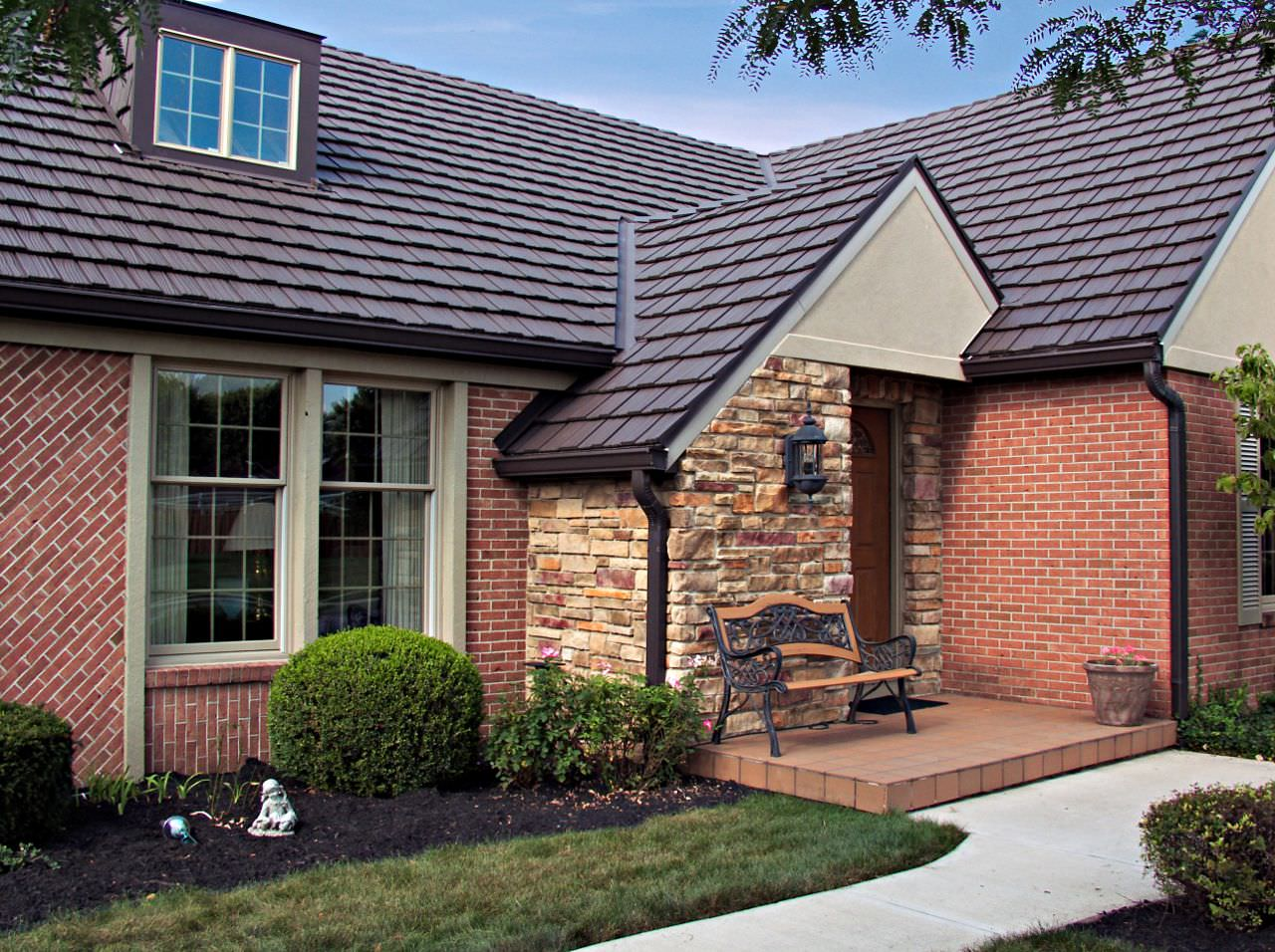 Metal roofing photos classic metal roofing systems for Metal roof pictures brick house